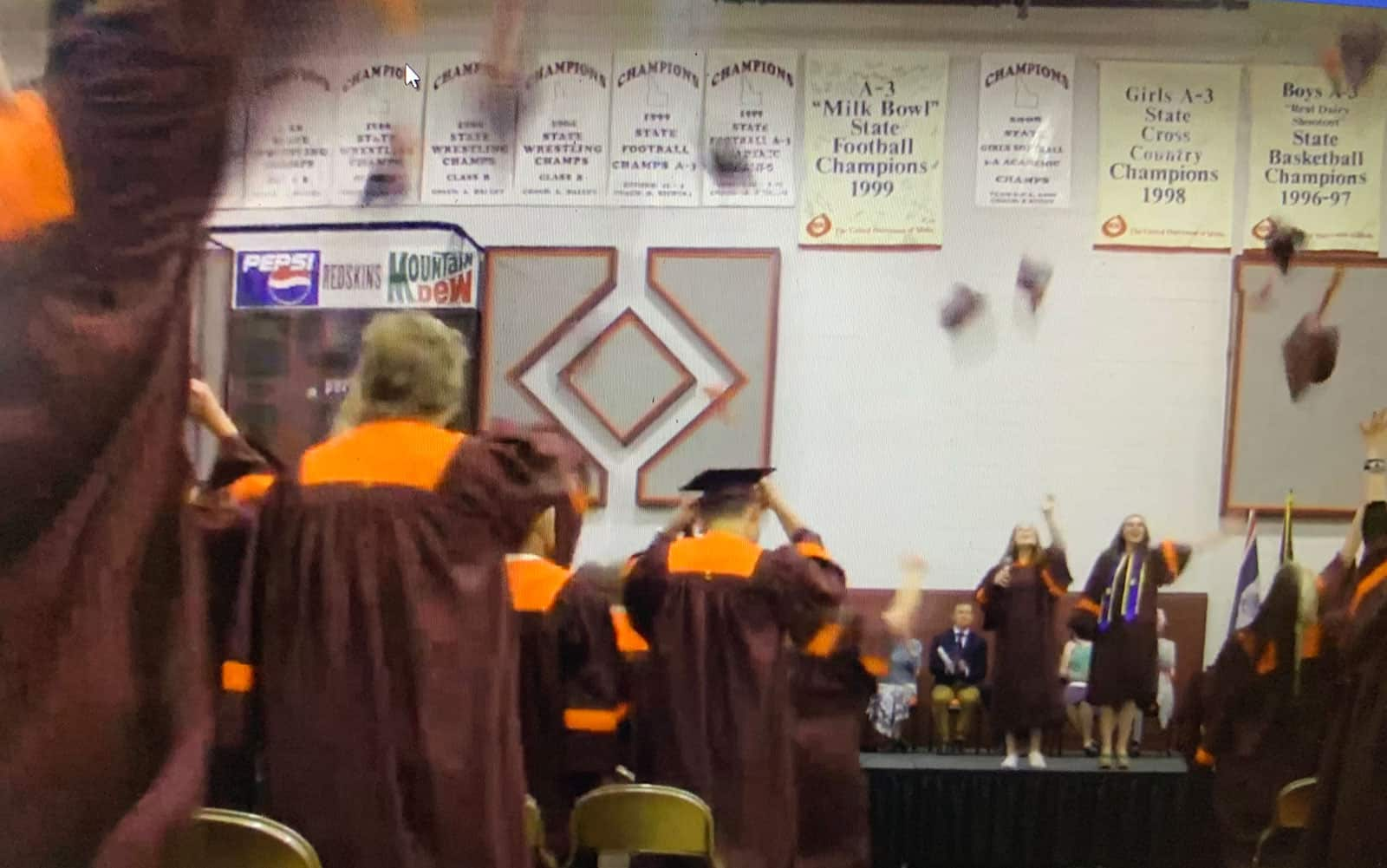 teton high school graduates throwing hats into air